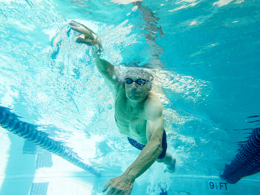 underwater view of senior man swimming competitively