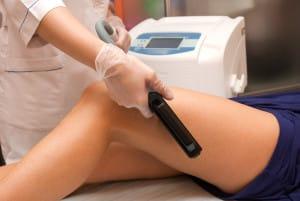 Laser epilation of leg in a modern beauty shop